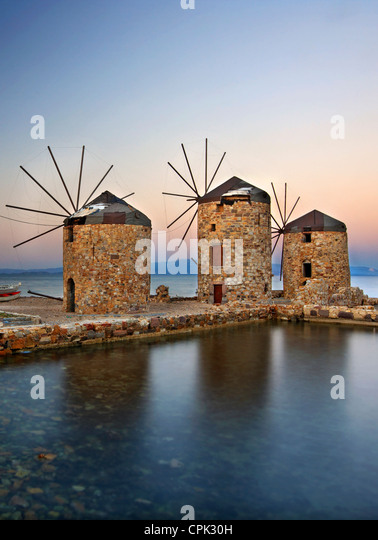 Beautiful windmills right by the sea in Chios town, Chios island, Northeast Aegean, Greece - Stock Image