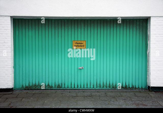 no parking,garage,garage door,parking prohibited - Stock Image