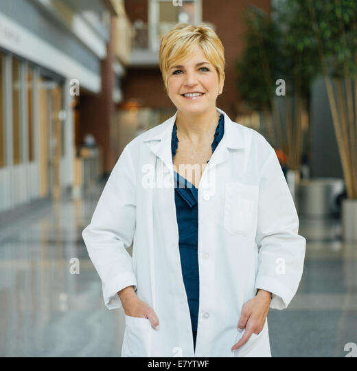 Portrait of woman in white coat - Stock Image