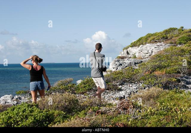Grand Turk Atlantic Ocean Hawknest Plantation Gun Hill dune buggy excursion tour couple Atlantic Ocean - Stock Image