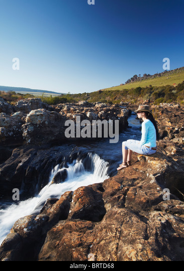 Woman at Lisbon Falls, Drakensberg Escarpment, Mpumalanga, South Africa (MR) - Stock Image