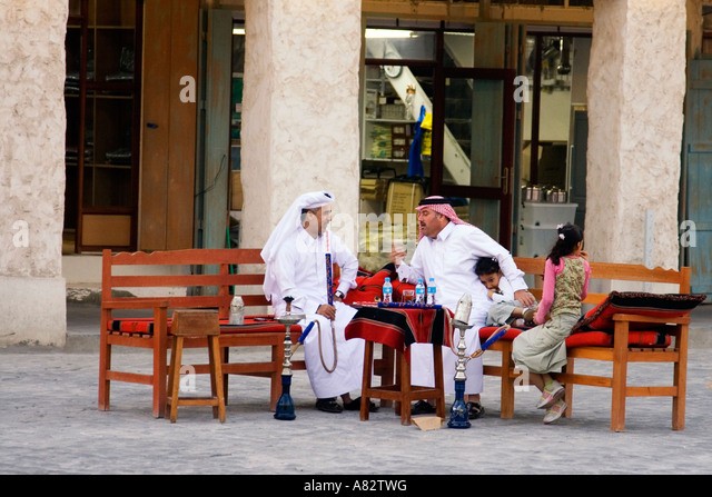 Qatar Doha Souk men smoking a sisha - Stock Image