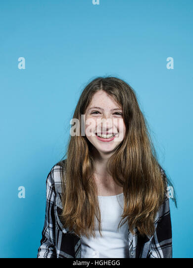 12yo female smiling studio portrait - Stock Image