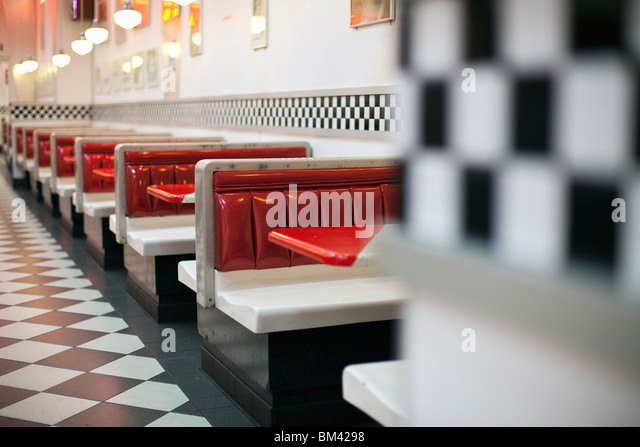 1950's style restaurant with checkered floor and rock'n'roll memorabilia. - Stock Image