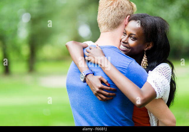 Couple in love hugging peacfully outdoors and being truly happy. Feeling of security and serenity - Stock-Bilder