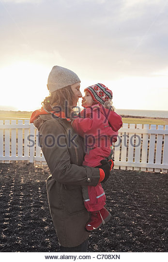Mother and daughter touching noses - Stock Image