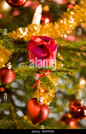 A close-up of a decorated Christmas tree. - Stock Image