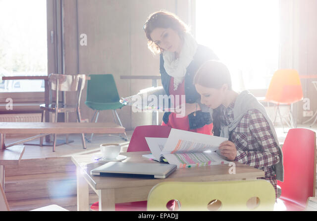 creative businesswoman document editing office - Stock Image