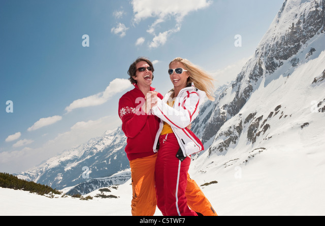 Austria, Salzburger Land, Couple dancing, laughing, portrait - Stock Image