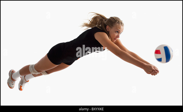 Young girl playing volleyball - Stock Image