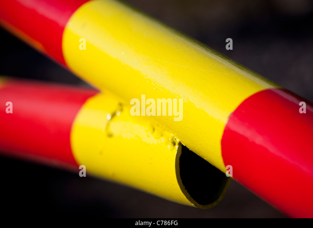 Closeup of red and yellow striped metal boom - Stock Image