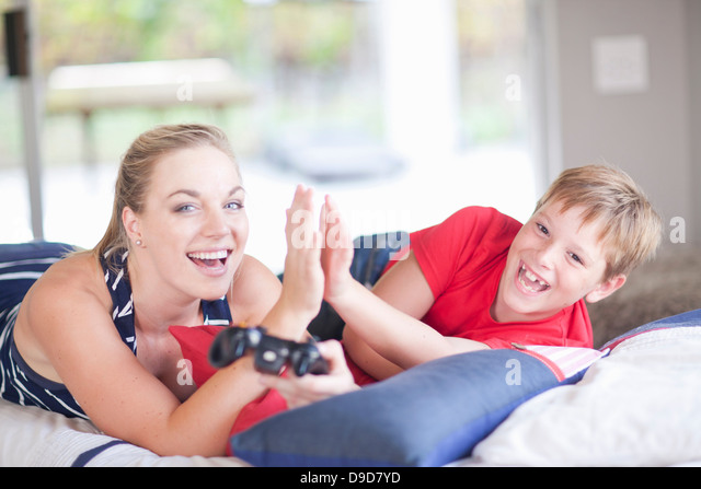 Woman and boy playing computer games - Stock Image