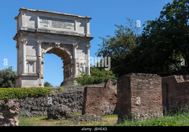 The Arch of Titus in the Roman Forum in the city of Rome, Italy. It was constructed in AD 82 by the Emperor Domitian. - Stock Image