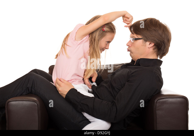 Young father play and make grimace to his daughter and she pointing her finger on his forehead in a brown leather - Stock Image