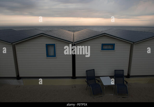 Holiday_behind the scene, rear view of beach houses, Wijk aan Zee, Netherlands - Stock Image