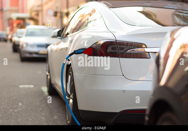 Electric Car in Charging Station. - Stock-Bilder