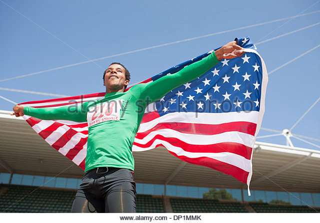 Runner celebrating on track with American flag - Stock-Bilder