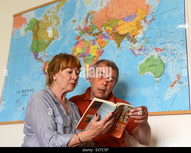 Booking planning travel holiday online via internet mature couple senior - Stock-Bilder