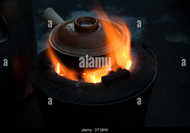 Pot simmering on a small barbeque, Yangon, Myanmar - Stock-Bilder