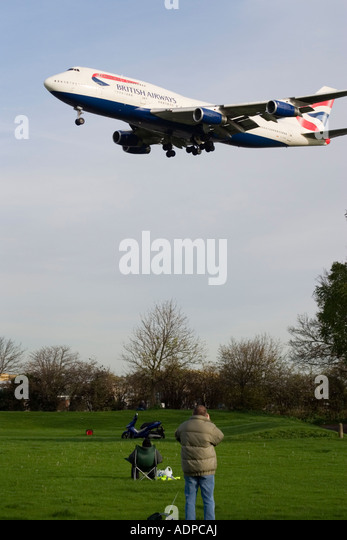 Plane spotters at London Heathrow Airport Hatton Cross, Myrtle Avenue, England, UK. - Stock Image