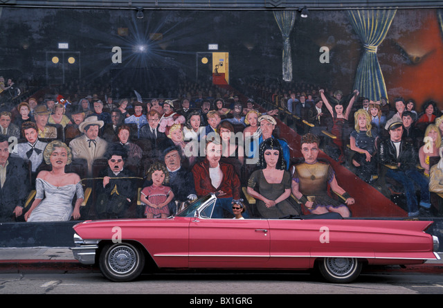 1962 Pink Cadillac Convertible woman car vintage car picture model released Hollywood Hollywood Mural Los An - Stock Image