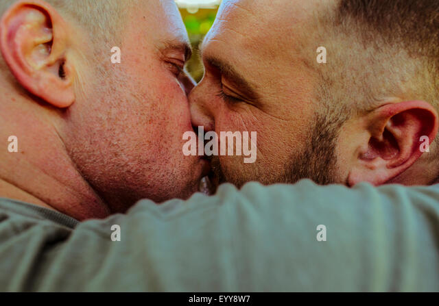 Close up of gay couple kissing - Stock Image