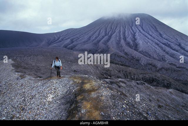 Costa Rica Liberia, Woman climbing the volcano at National Park Rincon de la Vieja - Stock Image