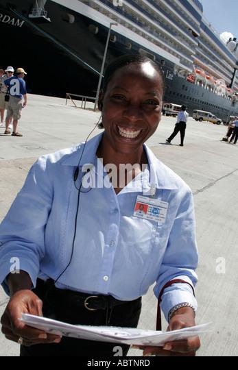 St. Thomas USVI Crown Bay Holland America Line ms Noordam Black female tour company manager - Stock Image