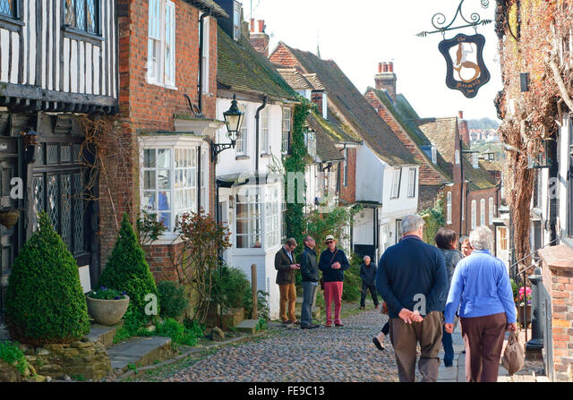 Visitors in the quaint and popular cobblestone Mermaid Street, in the historic ancient Cinque Port town of Rye, - Stock Image