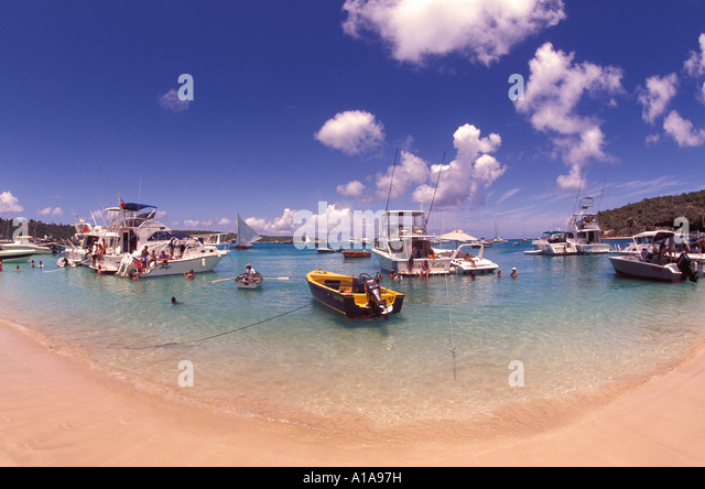 Anguilla beach Sandy Ground people partying on boats anchored offshore - Stock Image