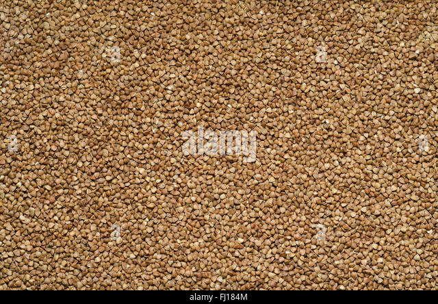 Background of buckwheat rassypannoj on surface - Stock Image