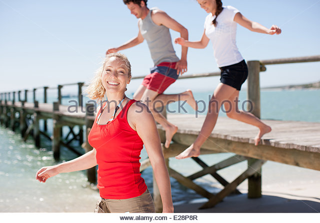 Friends playing on beach - Stock Image