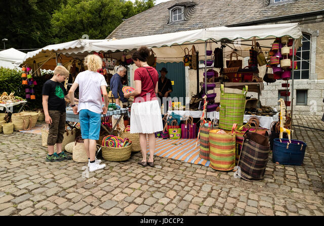 KORNELIMUENSTER, GERMANY, 18th June, 2017 - People browse the historic fair of Kornelimuenster on a sunny warm day. - Stock Image