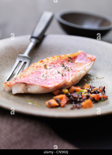 Close up of red mullet with wild rice - Stock Image
