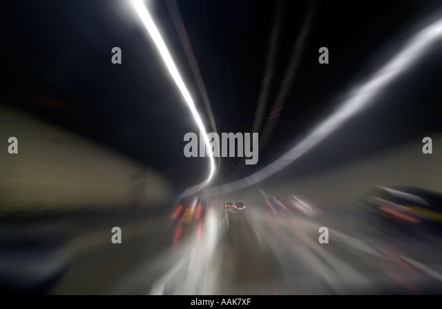 Zoom effect M-25 Orbital at night Tunnel London England United Kingdom - Stock Image