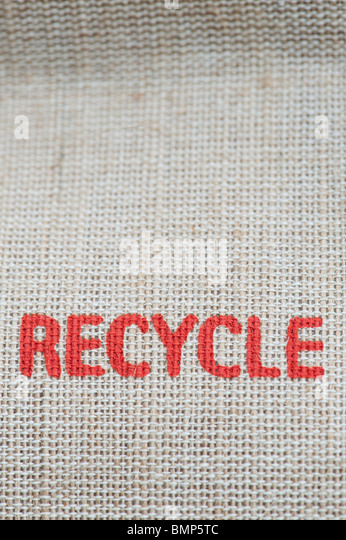 Recycle printed message on the side of a hessian shopping bag - Stock Image