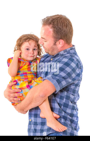 Father comforting his crying little daughter. Parenting concept. - Stock Image
