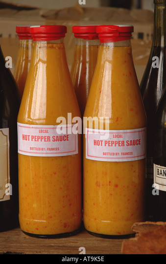 Castries St Lucia local spices hot pepper sauce produce market - Stock Image