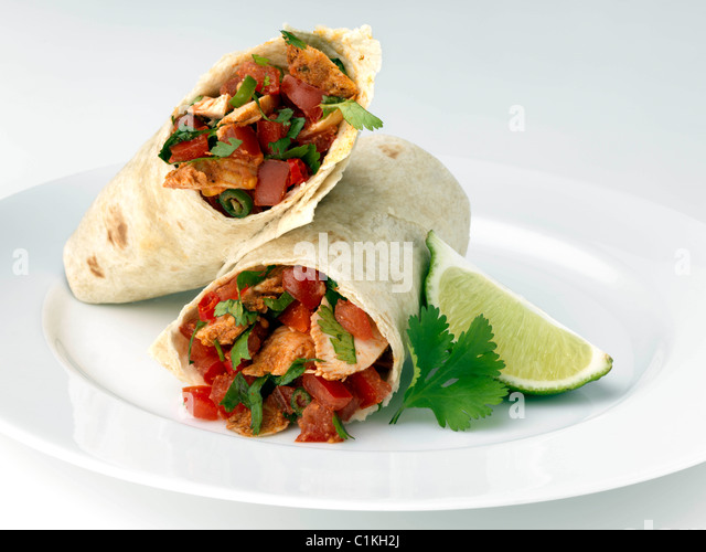 Spicy chicken burrito Mexican main meal - Stock Image
