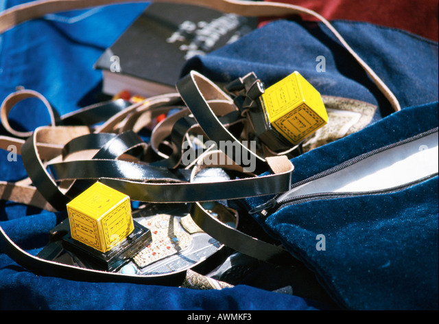 Tefillin (Jewish prayer objects consisting of leather straps and little boxes containing Torah), close-up - Stock Image