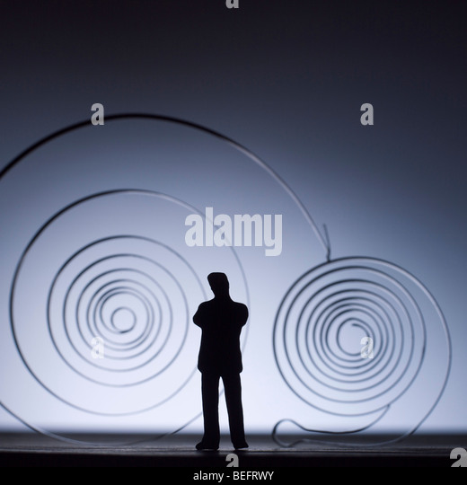 Creativity / ideas / invention / innovation / industry / manufacturing concept - metal spirals and businessman figure - Stock Image