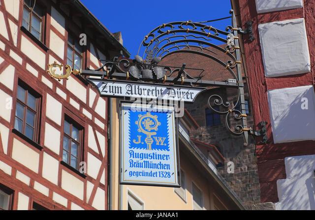 Nuremberg, sign post of a restaurant, Zum Albrecht Duerer und Augustiner Braeu Muenchen at the Tiergaertnertorplatz, - Stock-Bilder
