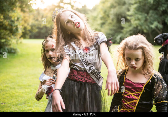 Two children dressed in costume for Halloween Night. - Stock Image