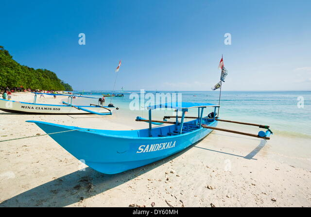 Outrigger boats on beautiful white sand beach in the national park on the south coast at Pangandaran, West Java, - Stock Image