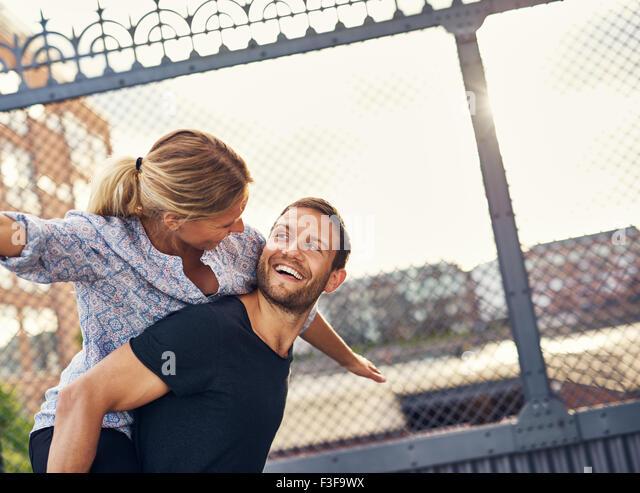 Loving Couple Having Fun, Woman on Mans Back, Piggyback - Stock-Bilder
