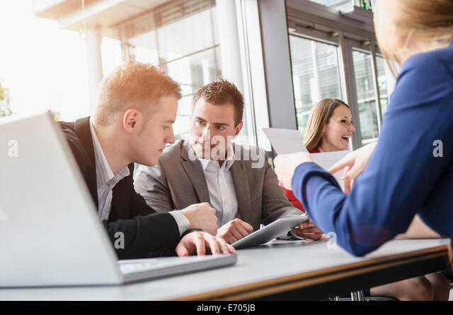 Business colleagues at brainstorming meeting - Stock Image