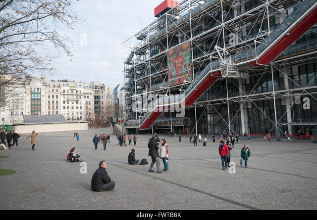People enjoying a Sunday afternoon outside Centre Georges Pompidou, in Paris France - Stock Image