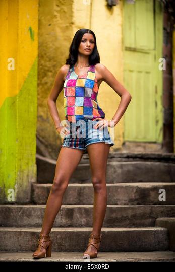 Young woman posing on stairway, Favela Santa Marta, Rio de Janeiro Brazil - Stock Image