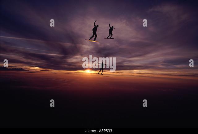 Skysurfers at sunset - Stock Image