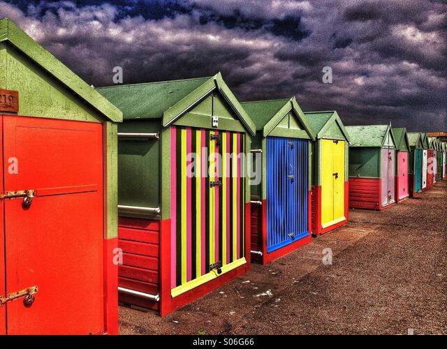 Row of beach huts at seaside - Stock Image